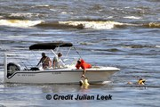 Way above 'DUTY', FWC officer jumps into the raging waters of inlet.