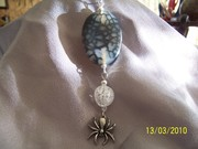 Flat Oval w rock crystal and spider charm