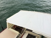 Hatch covered at anchor, roll back & clip when sailing but still covers cockpit