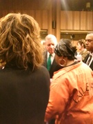 "Senator Durbin listening to a participant who wore an orange jumpsuit which had ""Stop the Torture"" written on it."