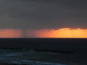 A rain burst off the coast