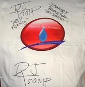 DJ Toomp signs Tears For Hope Foundation Tee Shirt