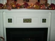 Oak mantel and Motawi tiles
