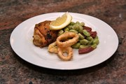 Salt and Pepper Squid, Chicken with Paprika, Garlic and Lemon, Broad Beans and Iberian Salchichón