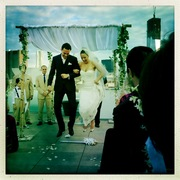 "Our very first clients jumping over the ""God is Love"" wedding broom!"