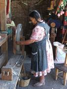 Alta Gracia López spinning skeins of wool