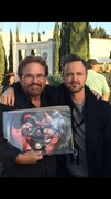 """Aaron Paul, Jim Hallowes, and the autographed """"Breaking Bad"""" poster"""