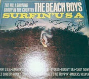 The Beach Boys 'Surfin USA' signed LP by Brian Wilson, David Marks and Mike Love.