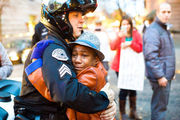 The Story Behind this Powerful Photo of a Black Boy Hugging a White Cop at a Ferguson Demonstration