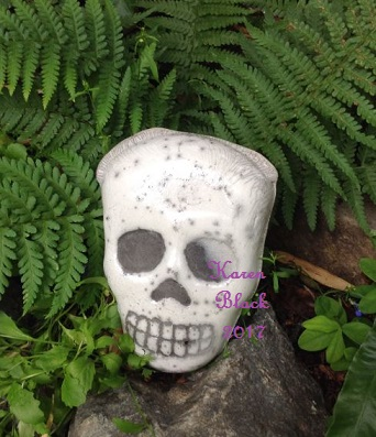 """Creepy Raku Skull"""