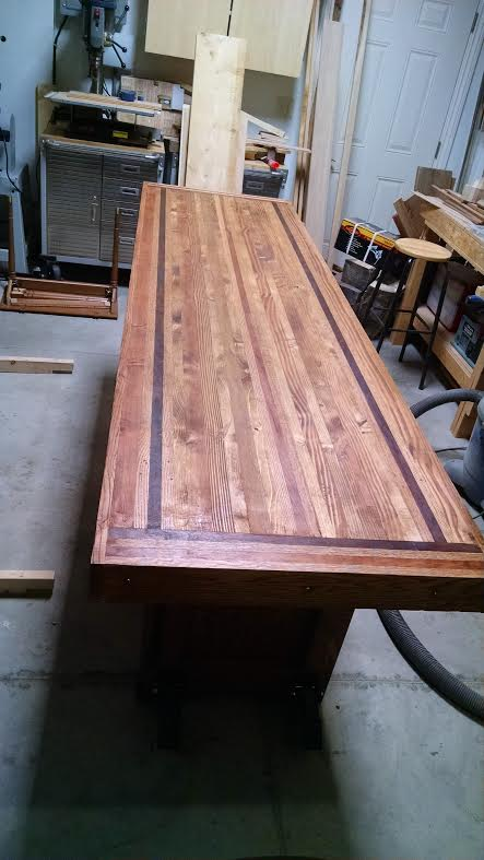 Workbench top from left over lumber and hardwood