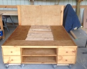 Storage bed with cubbies and drawers