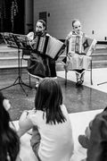 Two of my accordion on line students playing