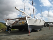 to many wharrams rest in a boatyard