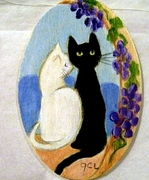 Two Cats -- One Black - One White