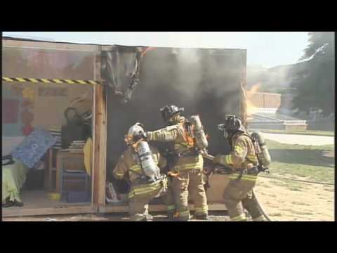 Firefighters on Fire at Sprinkler Demo : Close Call