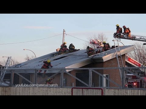 Longueuil, Canada: Firefighter Falls Off Roof
