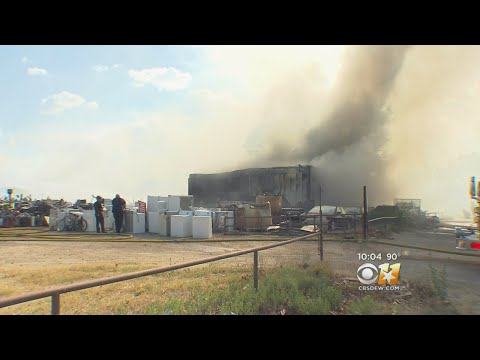 Texas Firefighters Battle Fire At Recycling Yard