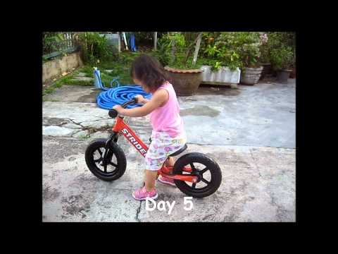 Kaopoon with her strider bike 1.8 years