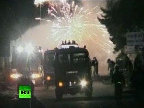 Police under 'firecracker attack' in clash over trash in Italy