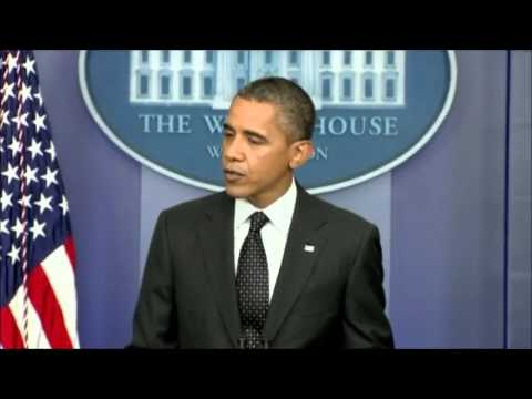 Obama warns Syria not to use chemical or biological weapons.