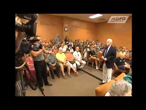 "Guy calls for John McCain to be ""arrested and tried for treason"" at town hall meeting"