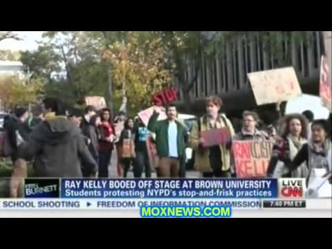 Presstitutes OUTRAGED That NYPD's Racist POS Leader Was BOOED OFF STAGE At Brown University