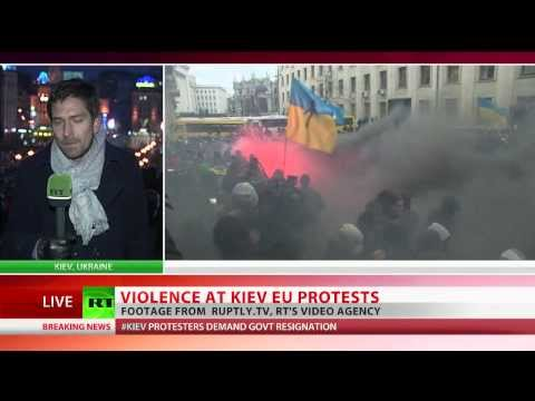 'Revolution!' Clashes as tens of thousands of pro-EU protesters rally in Kiev