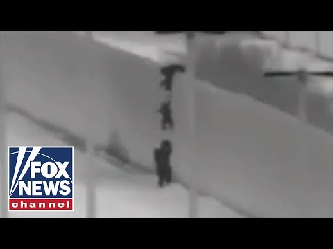 Migrant children seen being dropped over US border wall