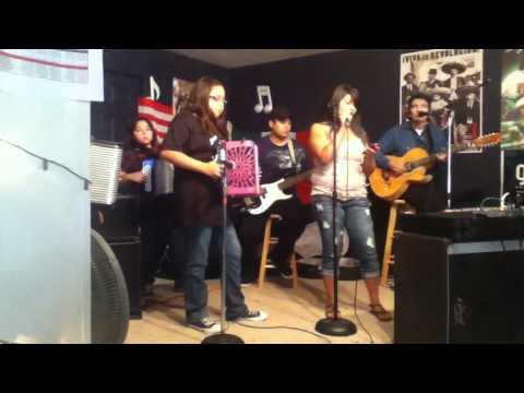 Bianca singing Tampico hermoso at the Conjunto jam.  10.16.11