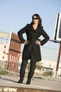 Selena in trenchcoat