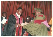 Bishop Albert receiving his doctorate's diploma