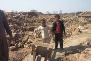 two child bring mud
