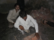 Pastor Asif working with the labor for church building