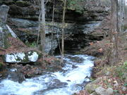 Fall Creek Flowing Into A Cave