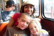 Elijah with mom and Maddie on the trolley in SD