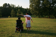 Brandon and Evan  in their yard