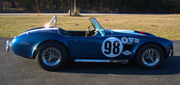 Ttiled as a 1965 Ford Cobra Build by RaceShop owner!