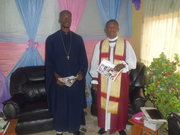 Standing beside my father,His Lordship,Bishop Bayo.