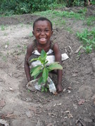 A girl named Hope planting a fruit tree in Malawi