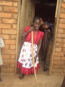 Mary (blind and lame) in Tanzania with new dress