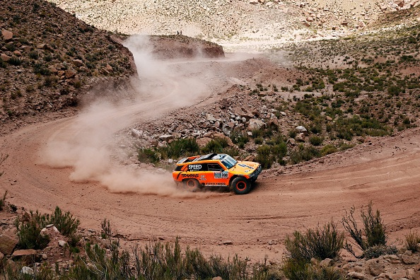 Caption:SAN SALVADOR DE JUJUY, ARGENTINA - JANUARY 14: #308 Robby Gordon and Johnny Campbell of the USA driving for Speed Energy Racing HST Hummer compete near the Salinas Grandes during Stage 10 on d