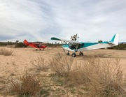A Cruzer and a STOL deciding where to go next in the California Hi Desert.