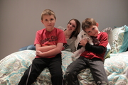 Mitch with his sister and younger brother in January.