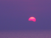 You can see the mountains of Sado Island covering the sun.