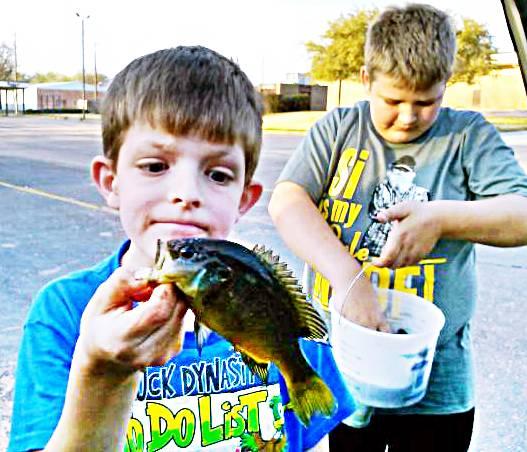 My nephews with some pretty fish