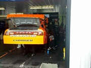 Robbys car getting worked on after qualifying