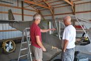 Jeff and Gary inspect windows