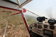 cockpit view during drop runs in the Afram Plains, Ghana, West Africa