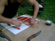 cody skewering salmon with maple
